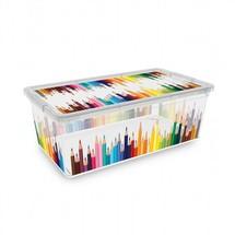 Une boite à jouets et une boite à crayon pleines de couleurs